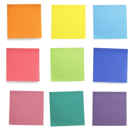 sticky: A set of officework related rainbow coloured paper post-it notes. Isolated on cork background.