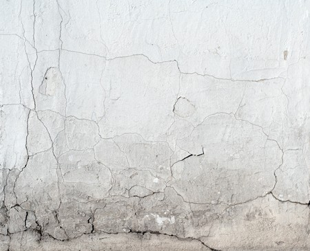 foundation cracks: Column foot with signs of past water damage.