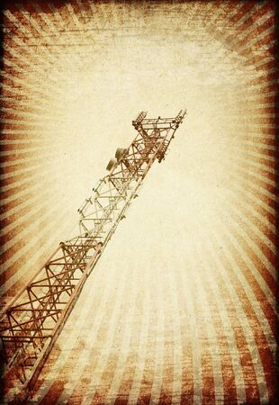 Grunge transmitter tower against sunburst image. photo