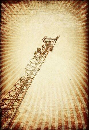 mast cell: Grunge transmitter tower against sunburst image. Stock Photo