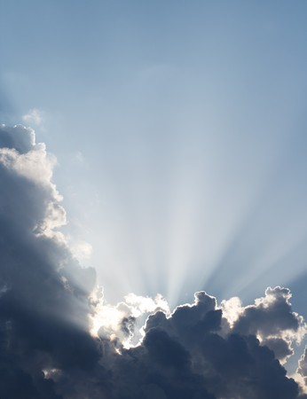 Spiritual sun rays through the clouds. Sky vertical background. photo
