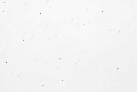 particles: Blank white hand-made textured paper background with colored particles. Stock Photo