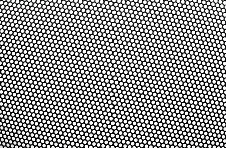 apertures: Black metal lattice with round apertures on white background. Close-up.