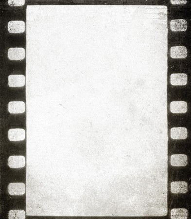 movie theater: Old grunge filmstrip - background with space for text Stock Photo