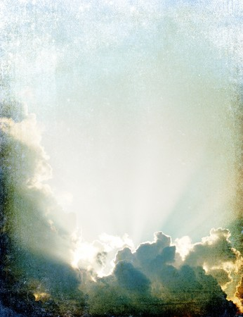 Vintage spiritual sun rays through the clouds. Old style imitation. photo