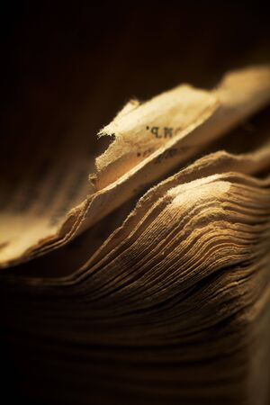 full frame: Vintage religious book - the edges of pages. Macro; shallow DOF.