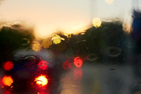 provincial: Rain drops with bokeh effect in provincial town at sunset. Stock Photo