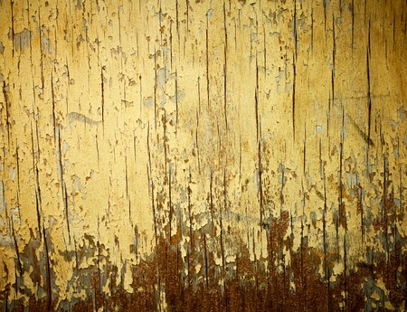 chipping: Yellow painted weathered wood texture.