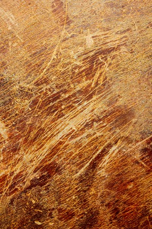 rusty background: Scratched veneer surface. Abstract grunge wood background.