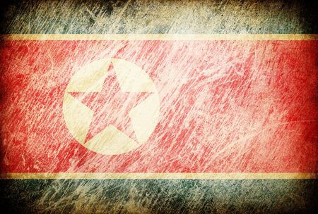 Grunge rubbed flag series of backgrounds. North Korea. photo