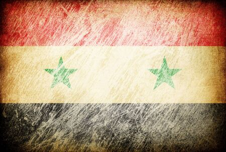 Grunge rubbed flag series of backgrounds. Syria. photo