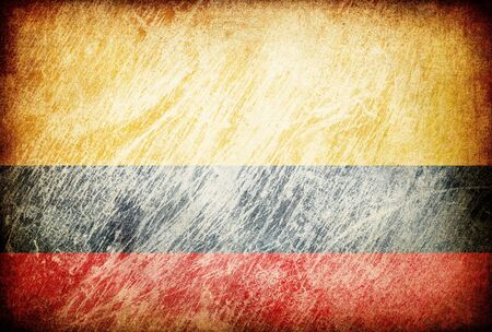 Grunge rubbed flag series of backgrounds. Colombia. photo