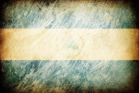 Grunge rubbed flag series of backgrounds. Nicaragua. photo