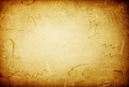 Texture of old paper with zodiac signs, abstract astrology theme background.
