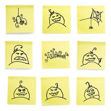 Yellow sticky papers set with some Halloween doodles.Isolated on white background. photo