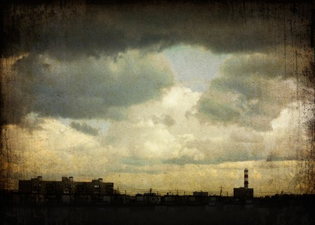 Sky with dramatic clouds over the ghetto (Moscow, Russia). Grunge background. photo