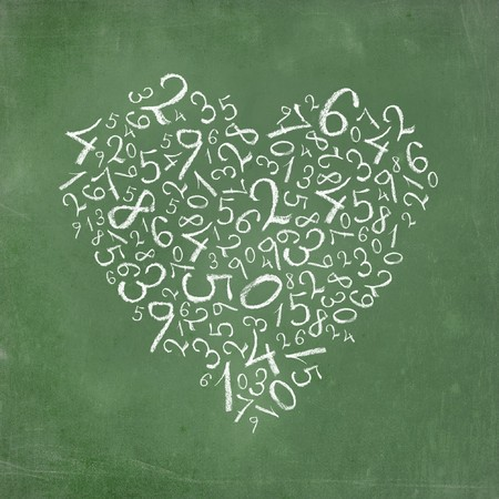 prime: Love of mathematics: heart shaped simple numbers on school-board texture.