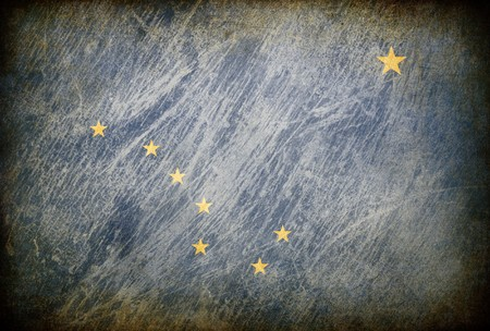 Grunge rubbed flag series of backgrounds. Alaska. photo