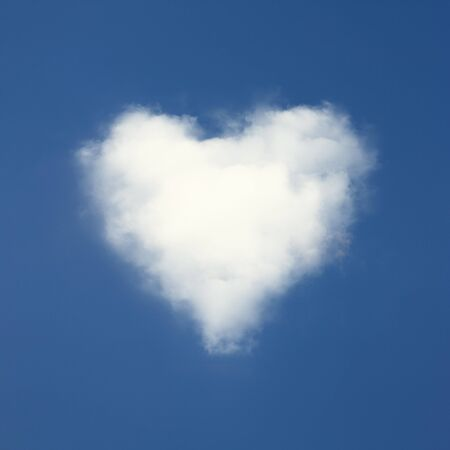 Heart shaped clouds on blue sky background. photo