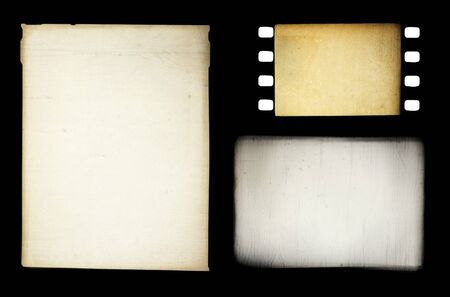 Set of grungy different film frames, isolated on black. photo