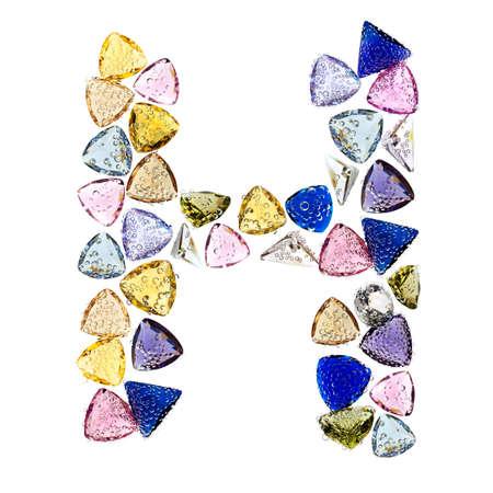 Gemstones alphabet, letter H. Isolated on white background. Stock Photo - 9201440
