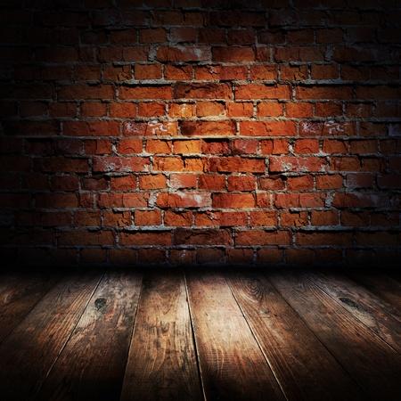 brickwalls: Interior of rural house. Brick wall and wooden floor scene. Stock Photo