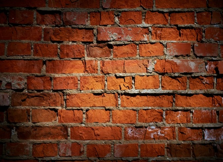 wall textures: Weathered stained old brick wall background