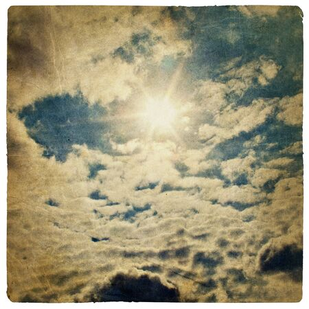 Sun on blue sky, vintage background. photo
