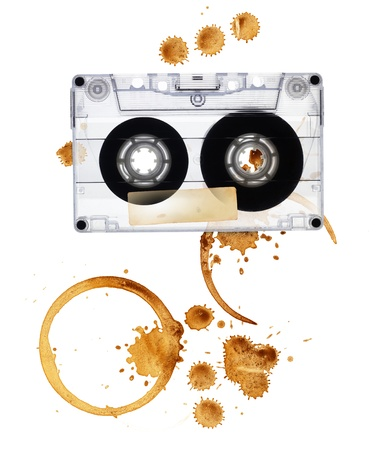 Vintage audio tape with coffee stains. Isolated on white background. Stock Photo - 10043767