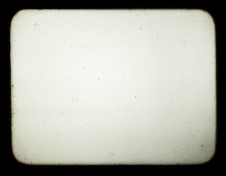 Instantánea de una pantalla en blanco del viejo proyector de diapositivas, adecuado para lograr el efecto de las fotos antiguas.
