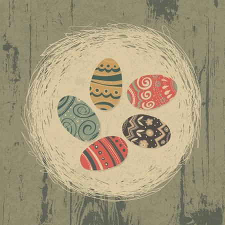nest egg: Easter eggs in nest on wooden texture. Easter background, retro styled.