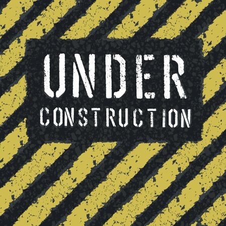 Under construction message on asphalt background photo