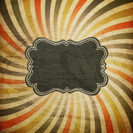 Grunge colorful rays background with vintage label for text.  photo