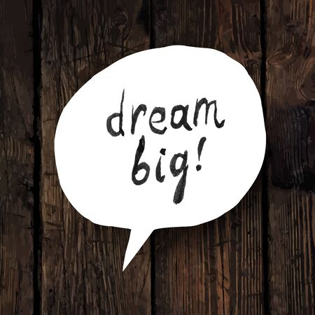 big idea: Dream big lettering in speech bubble on wooden texture
