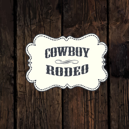 Western styled label on aged wooden wall background