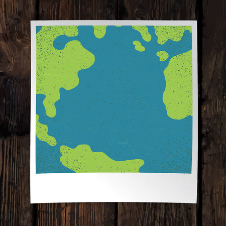 snapshot: Photo frame with Earth snapshot closeup. Earth day concept. With space for text. On wooden background. Design template. Illustration