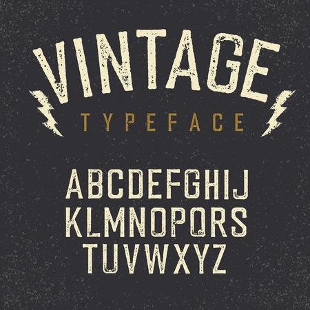 La tipografía retro de la vendimia. alfabeto estampado, letras blancas sobre fondo de textura rayado