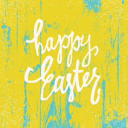 Carte de voeux de Joyeuses Pâques. Calligraphie dessinée à la main. Texture de fond en bois. Couleurs jaunes vives