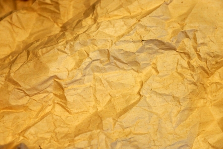 Old yellow crumpled wrapping paper    photo