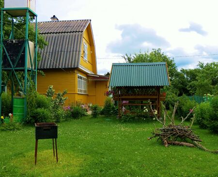 dacha: Wooden traditional USSR cottage in summer garden, Russia