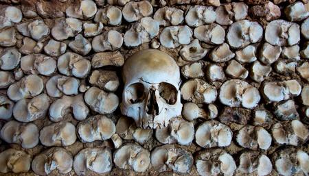 Wall of human bones in a chapel in Faro, Portugal photo