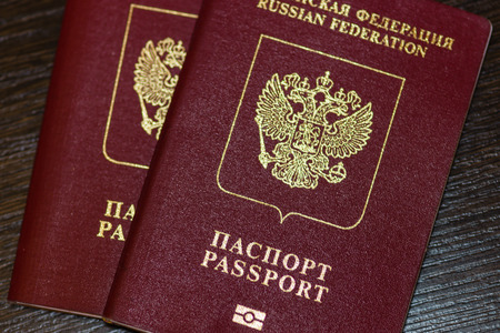 Russian passports isolated on wood background photo