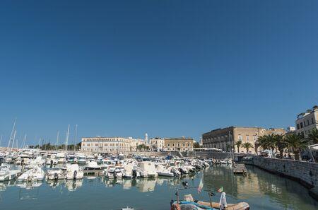 moored: Boats moored in port. Trani. Apulia, Italy.