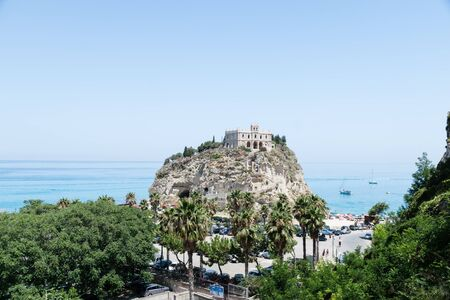 Church of Santa Maria dell'Isola located on the cliff near the town of Tropea, Italy Stock Photo