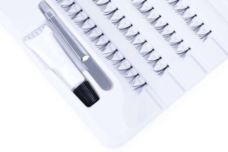 tenailles: Cils artificielles avec colle et tenailles