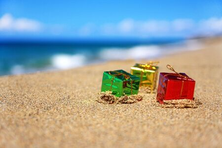 beach happy new year: Present boxes on beach