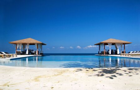 dominican republic: Two summerhouses with swimming pool near ocean Stock Photo