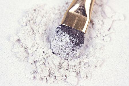 Applicator and crumbled white eyeshadows Stock Photo - 6667014