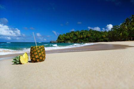 colada: Pina colada with pipe on beautiful beach Stock Photo