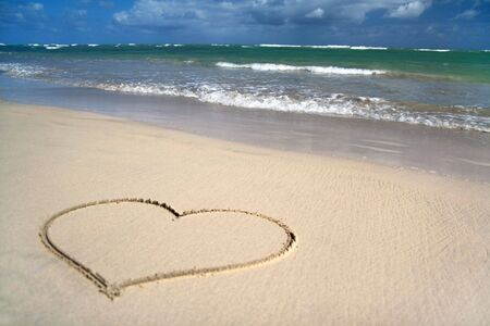 dominican republic: Draw heart on  wet sand at the coast